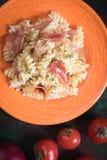 Italian pasta with prosciutto Stock Image
