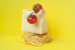 Italian pasta with cheese and tomatoes Stock Images