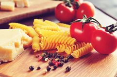 Italian pasta with cheese tomatos and peppers Royalty Free Stock Image