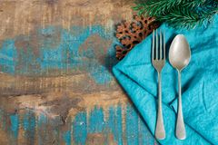 Italian pasta Christmas dinner concept with blue napkin and chri Stock Images