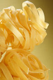 Italian pasta close-up on yellow gradient Stock Photos
