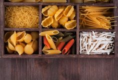 Italian pasta collection in wooden box Stock Photography