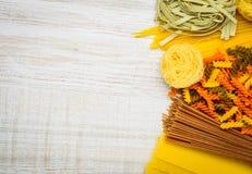 Italian Pasta Copy Space Area. Copy Space Area with Italian Cuisine Food Pasta, Tagliatelle, colored Fusilli, Spaghetti and Lasagne Stock Photos