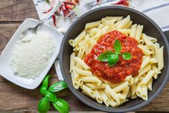 Italian pasta dish. Macaronni with bolognese sauce and basil with grilled cheese Stock Photography