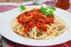 Italian pasta dish. Italian pasta spaghetti with bolognese sauce and basil Royalty Free Stock Photography