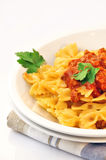 Italian pasta farfalle with meat and tomato sauce Stock Photography