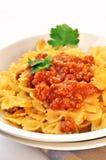 Italian pasta farfalle with meat and tomato sauce Stock Photo