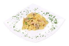 Italian pasta farfalle with mushrooms. Royalty Free Stock Photo