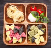Italian pasta, farfalle, tomato, garlic and basil Royalty Free Stock Photo