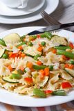 Italian pasta farfalle with vegetables closeup  vertical Royalty Free Stock Photography