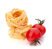 Italian pasta fettuccine nest  and cherry tomato Royalty Free Stock Image