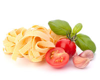 Italian pasta fettuccine nest  and cherry tomato Stock Photography