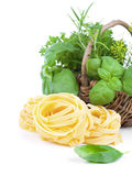 Italian pasta fettuccine nest with fresh basil leaves Royalty Free Stock Photos