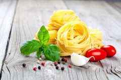 Italian pasta fettuccine nest with garlic, Royalty Free Stock Image