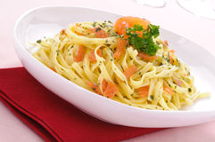 Italian pasta , fettuccine with smoked salmon Stock Photography