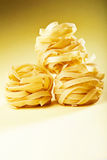 Italian pasta fettuccine on yellow gradient Stock Image