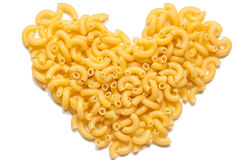 Italian pasta in the form of heart royalty free stock images