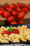 Italian pasta with fresh tomato sauce and parsley Stock Photos