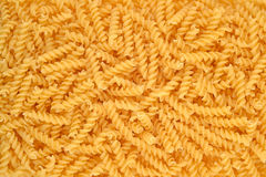 Italian pasta fusilli background. Food background texture Stock Photos