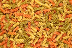 Italian pasta fusilli background. Food background texture Royalty Free Stock Photography