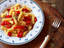 Italian pasta fusilli with red peppers Stock Photography