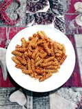 Italian pasta: fusilli with tomato royalty free stock image