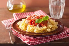 Italian pasta fusilli with tomato sauce and basil Royalty Free Stock Photography