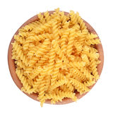 Italian pasta fusilli in a wooden bowl on a white background Royalty Free Stock Photography