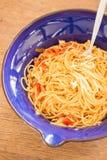 Italian pasta with ham, tomato and champignon mushrooms Royalty Free Stock Images