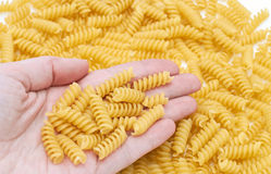 Italian pasta in hand Stock Images