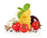 Italian pasta ingredients. Italian pasta, cherry tomatoes with  basil and garlic  on white background Stock Photos