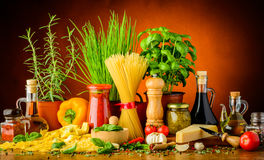 Italian pasta ingredients. Still life with traditional italian pasta ingredients, herbs and spices Royalty Free Stock Photography