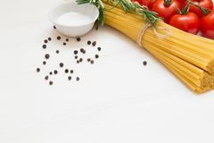 Italian pasta ingredients on white wooden table, macro royalty free stock image