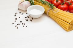 Italian pasta ingredients on white wooden table, macro stock images