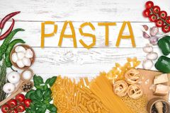 Italian pasta ingredients on white wooden table, top view Stock Photo