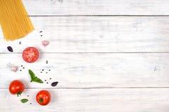 Italian pasta ingredients on white wooden table, top view Stock Photos