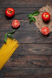Italian pasta ingredients on white wooden table, top view, copy space Stock Photos