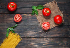 Italian pasta ingredients on white wooden table, top view, copy space Royalty Free Stock Image