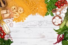 Italian pasta ingredients on white wooden table, top view Stock Photography