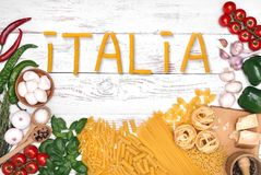 Italian pasta ingredients on white wooden table, top view Stock Image