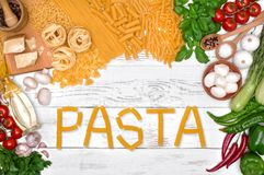 Italian pasta ingredients on white wooden table, top view Stock Photos