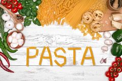 Italian pasta ingredients on white wooden table, top view Royalty Free Stock Images