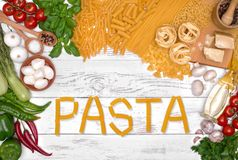 Italian pasta ingredients on white wooden table, top view Royalty Free Stock Photos