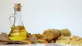 Italian pasta, Italian pasta ingredients, flour, pasta assortment of olive oil in a bottle, still life, spices spaghetti, studio s stock video footage