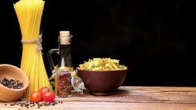 Italian pasta, Italian pasta ingredients, flour, pasta assortment of olive oil in a bottle, still life, spices spaghetti, studio s stock footage