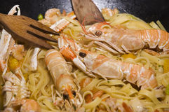 Italian pasta and lobsters stock images