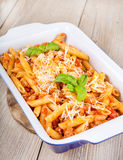 Italian pasta with meat sauce and parmesan cheese Stock Images