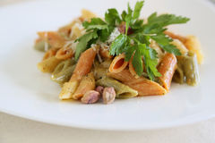 Italian pasta: mezze penne tricolore with pistachios pesto Royalty Free Stock Photos