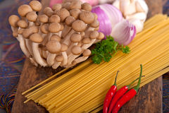Italian pasta and mushroom sauce ingredients Royalty Free Stock Images
