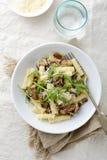 Italian Pasta with mushrooms, arugula and parmesan Royalty Free Stock Photos